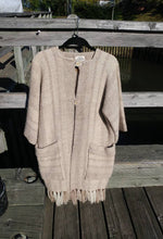 "Load image into Gallery viewer, Kingspier Vintage - This unique Daurene Lewis designer coat / jacket has two patch pockets and genuine ""horn"" buttons with wool fringe at the base. The natural tones of wool are woven in classic oversized herringbone pattern and is handwashable"