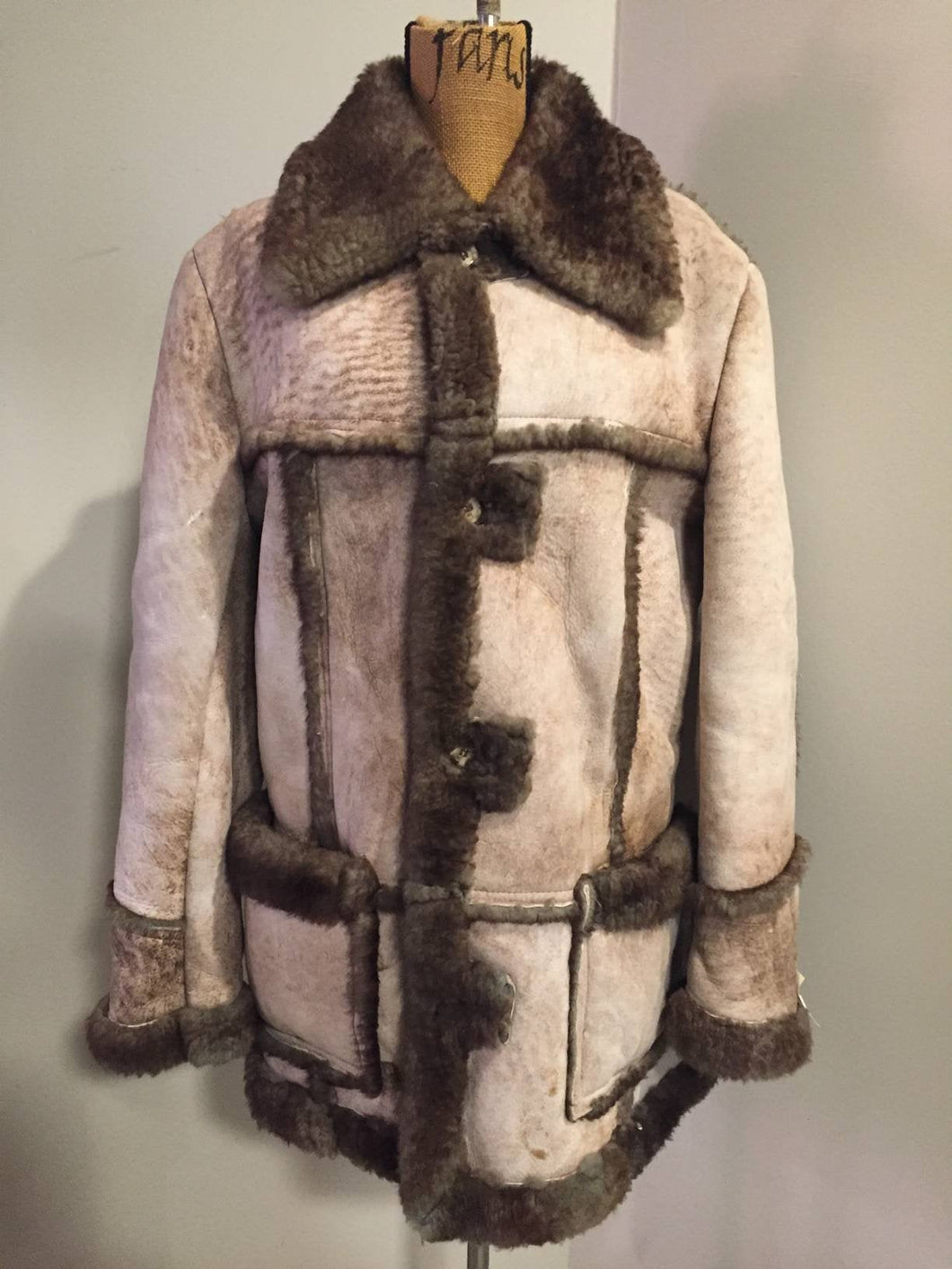 Kingspier Vintage - This robust sheepskin is in remarkable shape. Wool is still as lofty as new. I believe this coat was manufactured in the 60's. Made in Canada.