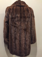 Load image into Gallery viewer, Kingspier Vintage - Vintage mid-century mink coat from Ward's (Ward Brothers) Department Store. Made in Lewiston, Maine. Frog / Hook and eye snap closures, beautiful brown lining with a subtle floral pattern