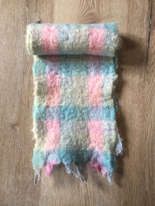 Kingspier Vintage - <p>Multi-coloured handknit mohair scarf featuring shades of blue, pink, and yellow. Almost like cotton candy! Measures 7.5x56 inches.</p>