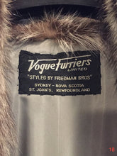 Load image into Gallery viewer, Vogue Furriers, Styled by Friedman Brothers, full length raccoon coat. Made in Sydney, Nova Scotia, Canada.