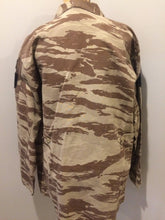 "Load image into Gallery viewer, Kingspier Vintage - This desert camouflage light military jacket is in great condition. Made of cotton with 4 large cargo pockets, velcro rank patches, and ""Houston"" embroidered name patch. Size L."