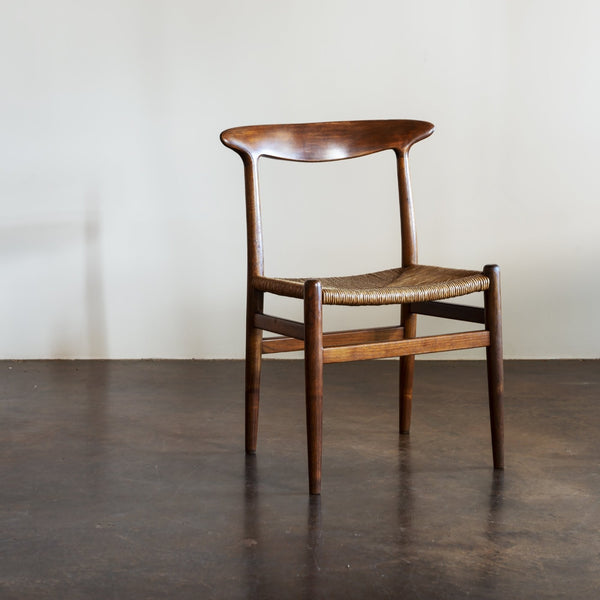 Hans Wegner Set of Four Model W2 Dining Chairs in Oak, Denmark, 1950s