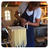Jake from Jake's Kitchen cooking pasta for guests