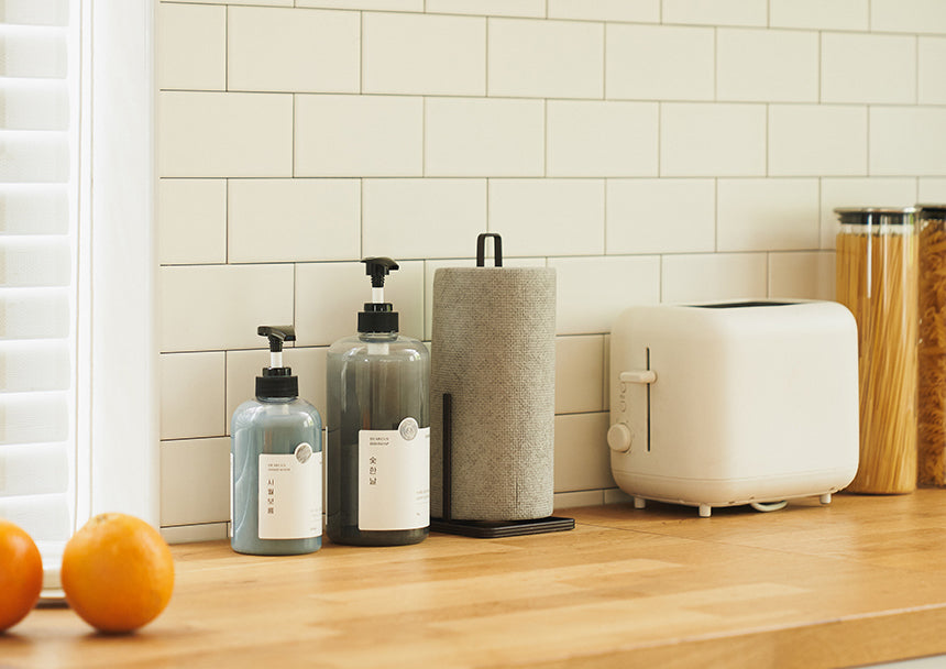 Dearcus handsoap series displayed on kitchen countertop with oranges.