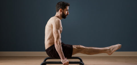 L-sit exercise on the Pbar