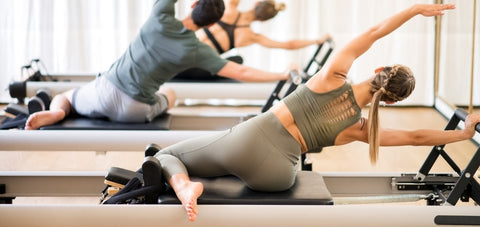 side bend exercise done on the Pilates Reformer