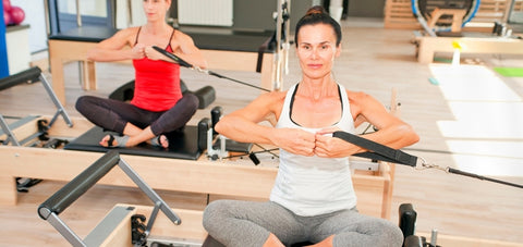 arm exercise done on the straps of the Pilates Reformer