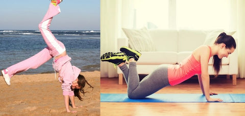 a lady doing a handstand kick up and another lady doing kneeling pushups