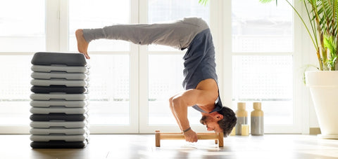 demonstration of a man doing elevated pike push up