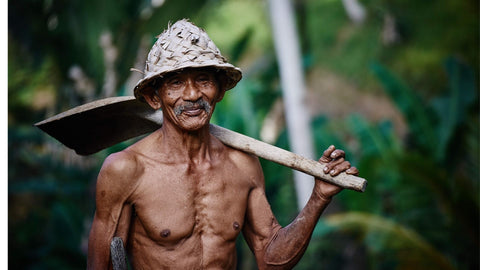 old villager displaying a good physique because of regular daily movements