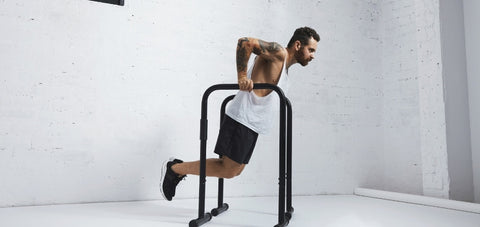 Dip exercise demonstration on a portable parallel bar