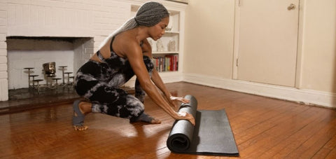 lady getting ready for mat exercise at home