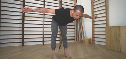 Narrow stance hip hinge shown by Michel to target more of the Hamstring muscle stretch
