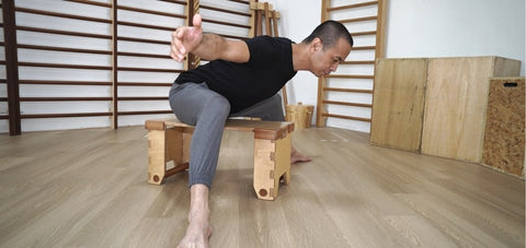 Seated hip hinge demonstrated by Michel Velasco