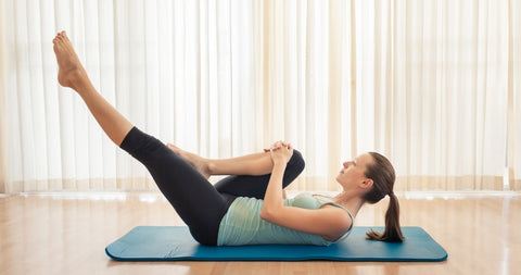 Pilates single leg kick exercise done in a Strength pilates mat class in Singapore