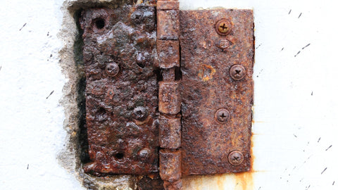 Rusty door hinge representing an old, unmaintained joints of the body