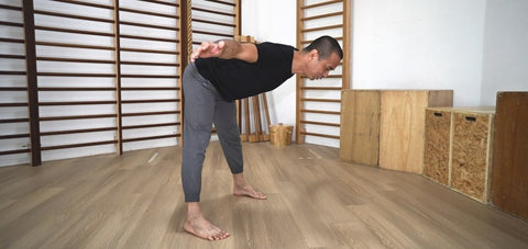 Michel Velasco showing a hip hinge exercise to stretch the hamstrings