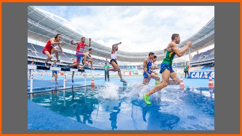 Many Athletic People Running and Jumping over Water, Hurdles and Obstacles in a Race