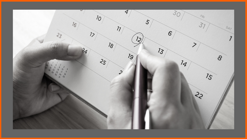 Marking on a Calendar to Schedule Exercise and Workout Days