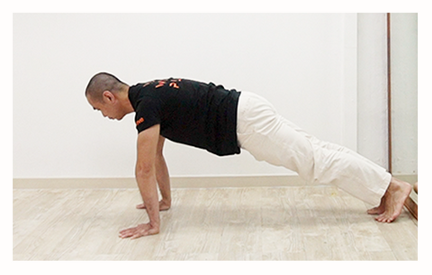 tight plank line demonstrated by UMove teacher to start with the push up exercise