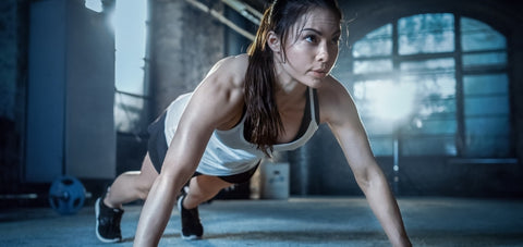 start of a push up position demonstrating a compound body exercise where most of the muscles are working
