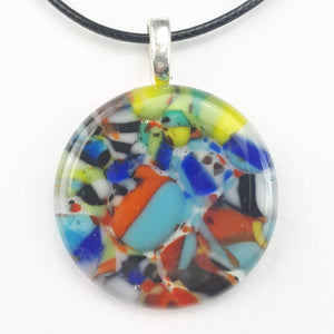 multicoloured round glass pendant on white background