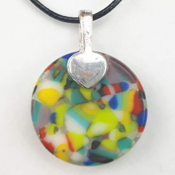 back of colourful round glass pendant on white background