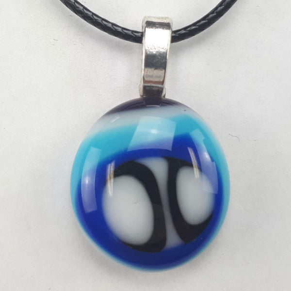 Blue, White & Black oval pendant on white background