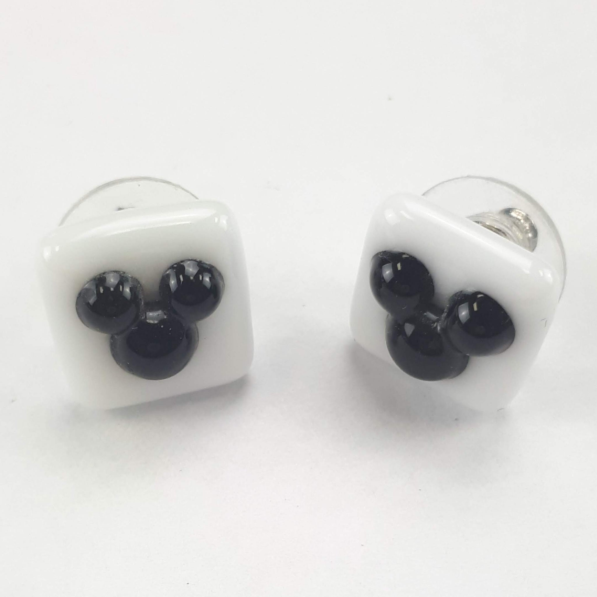 black and white mouse silhouette stud earrings on white background