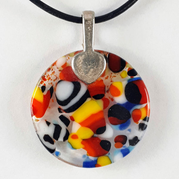 Back of Coloured round glass pendant on white background