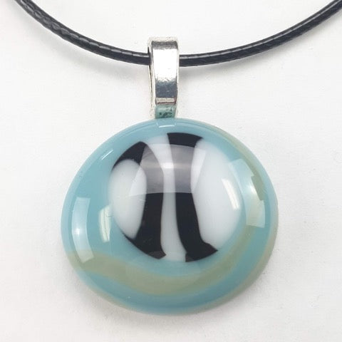 Blue, white and black pendant on black leather necklace