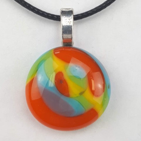 Colourful round pendant on white background