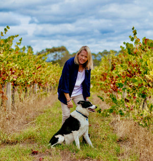 Bellarmine vineyard winemaker Di Miller with Mumford the dog