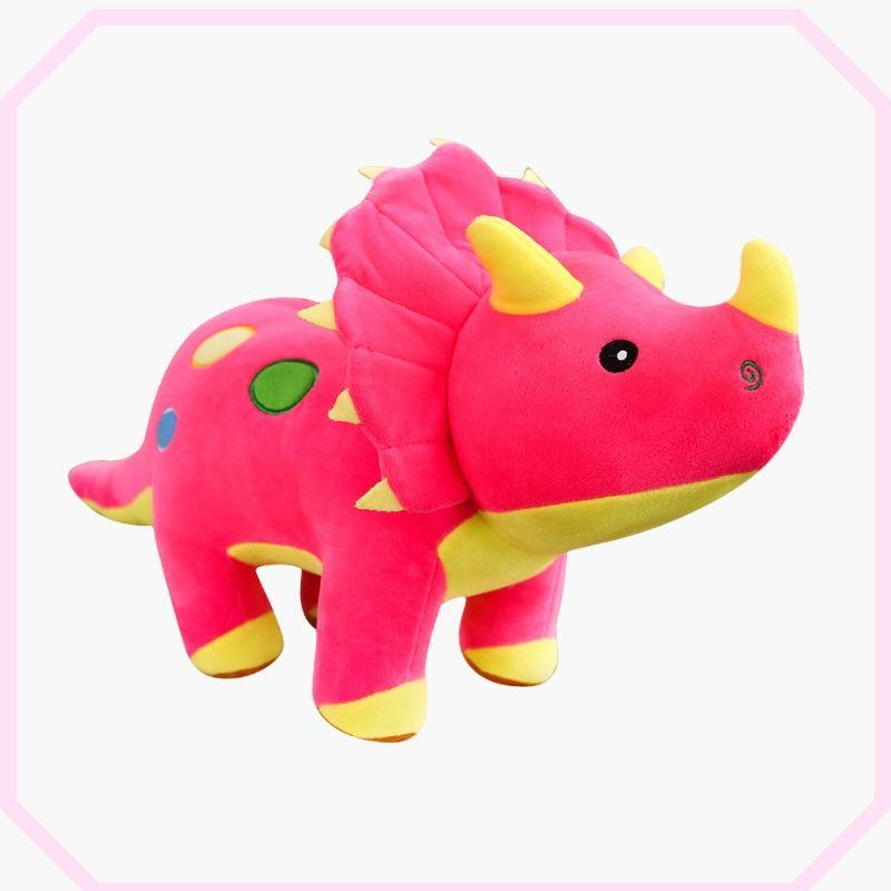 peluche dinosaure tricératops rose debout