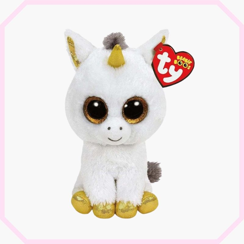 peluche licorne blanche et or assis