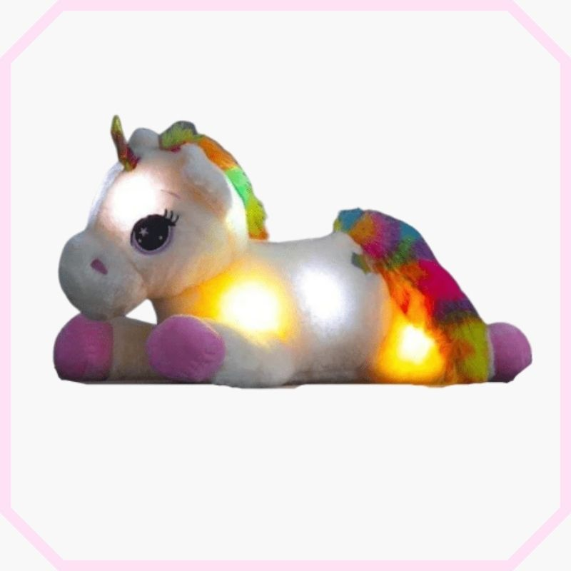 peluche licorne lumineuse rose couchée.