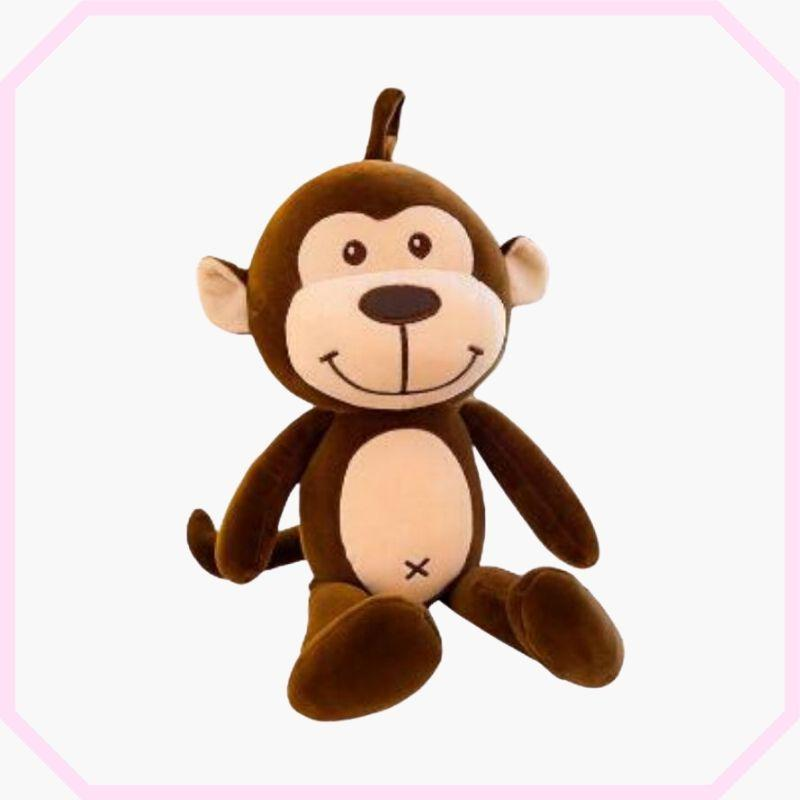peluche singe marron en position assis.