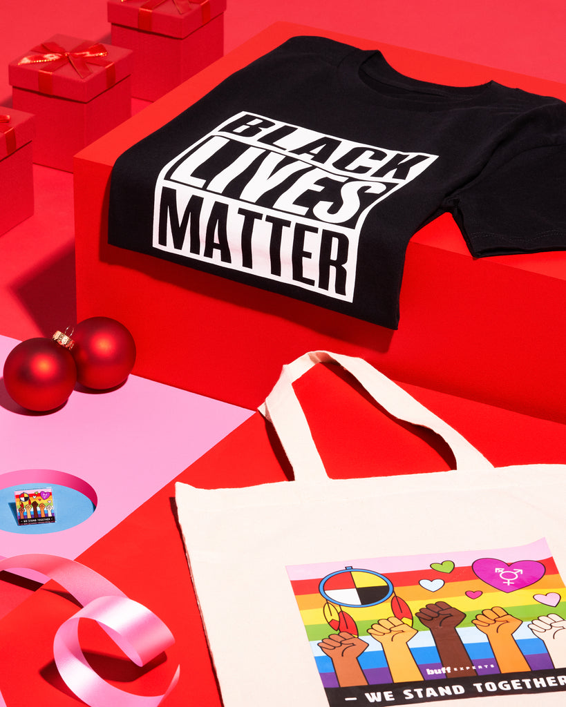This bundle includes a Black Lives Matter Tee, a We Stand Together Tote Bag, a We Stand Together Acrylic Pin