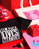 This bundle includes a Black Lives Matter Tee, a Can't, It's Hair Wash Day Tote Bag and a Can't, It's Hair Wash Day Acrylic Pin