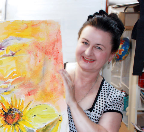 Artist Ginette with large sunflower watercolor and ink