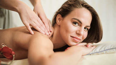 Beautiful girl getting essential oil massage