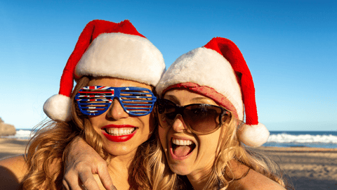 Two beautiful girls with Christmas hats