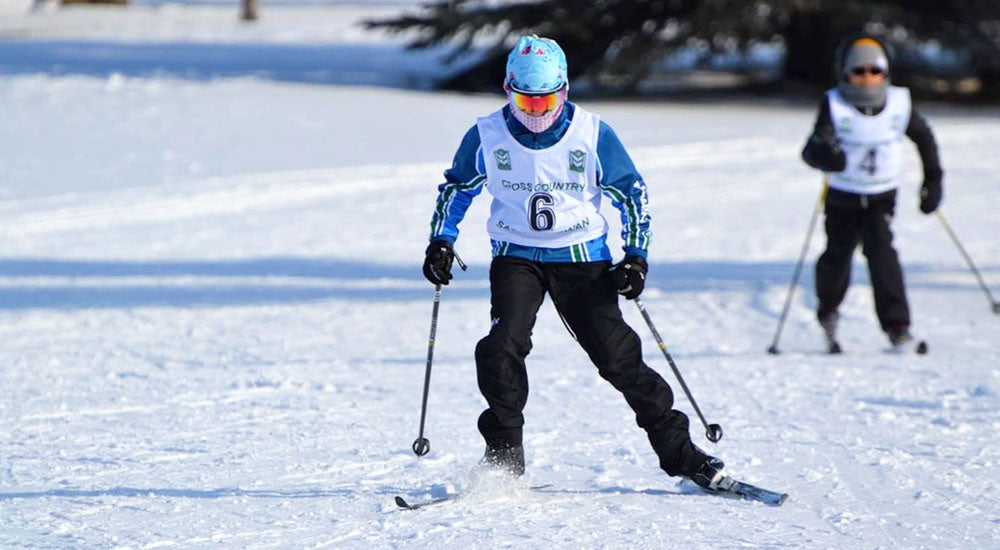 Child skiing with sunglasses