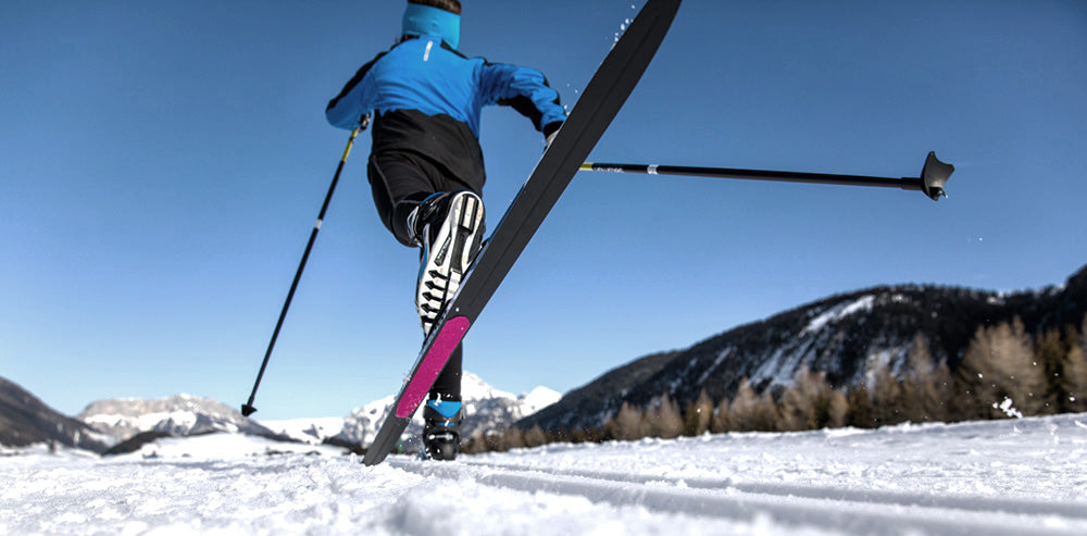 Skier using skin skis