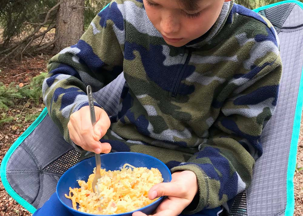 kid eating hashbrowns on trip