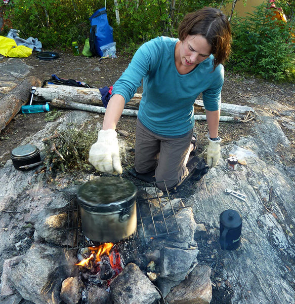making camp popcorn over fire