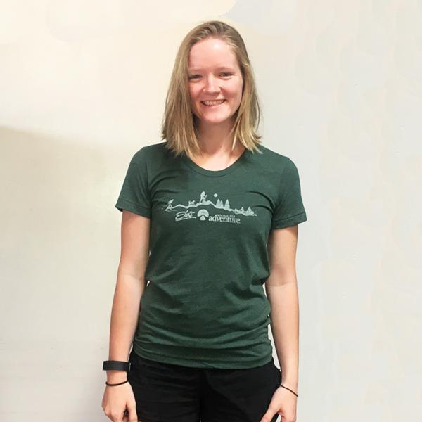 woman wearing green Eb's t-shirt