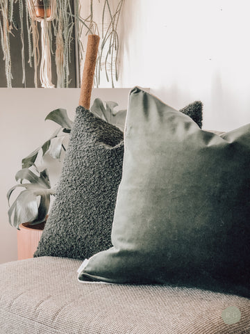 Snugly green boucle and green velvet cushions