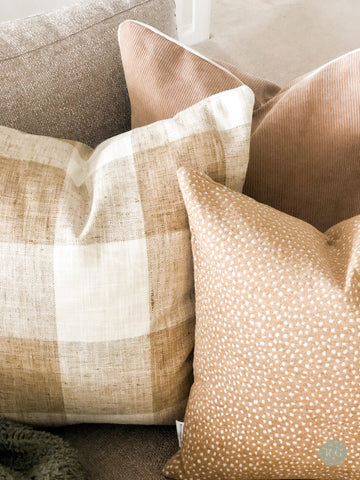 Cushion combination showing textures and prints